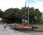 hoisting the mast on the double canoe